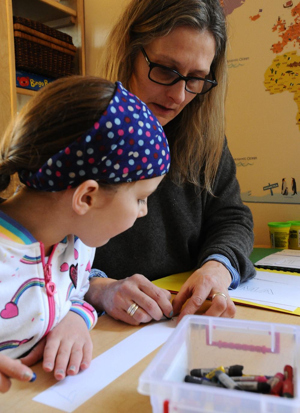 teacher working with preschooler