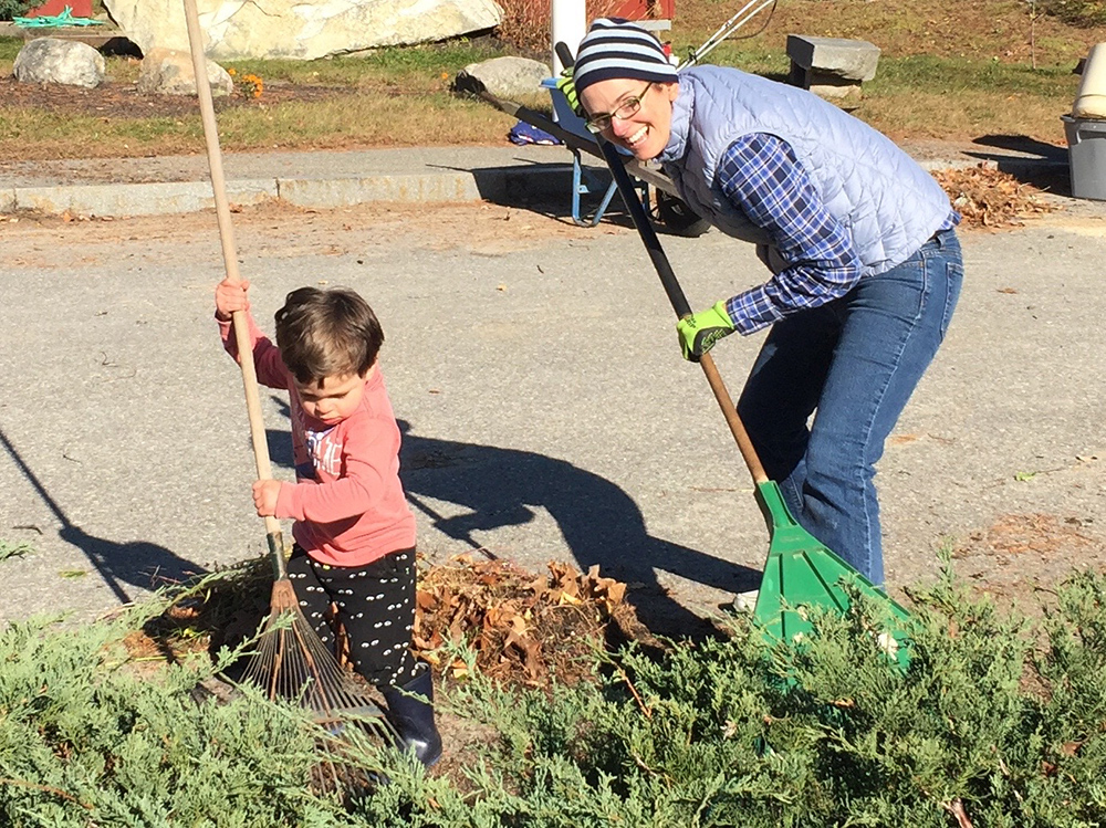 Miss Lisa and child raking