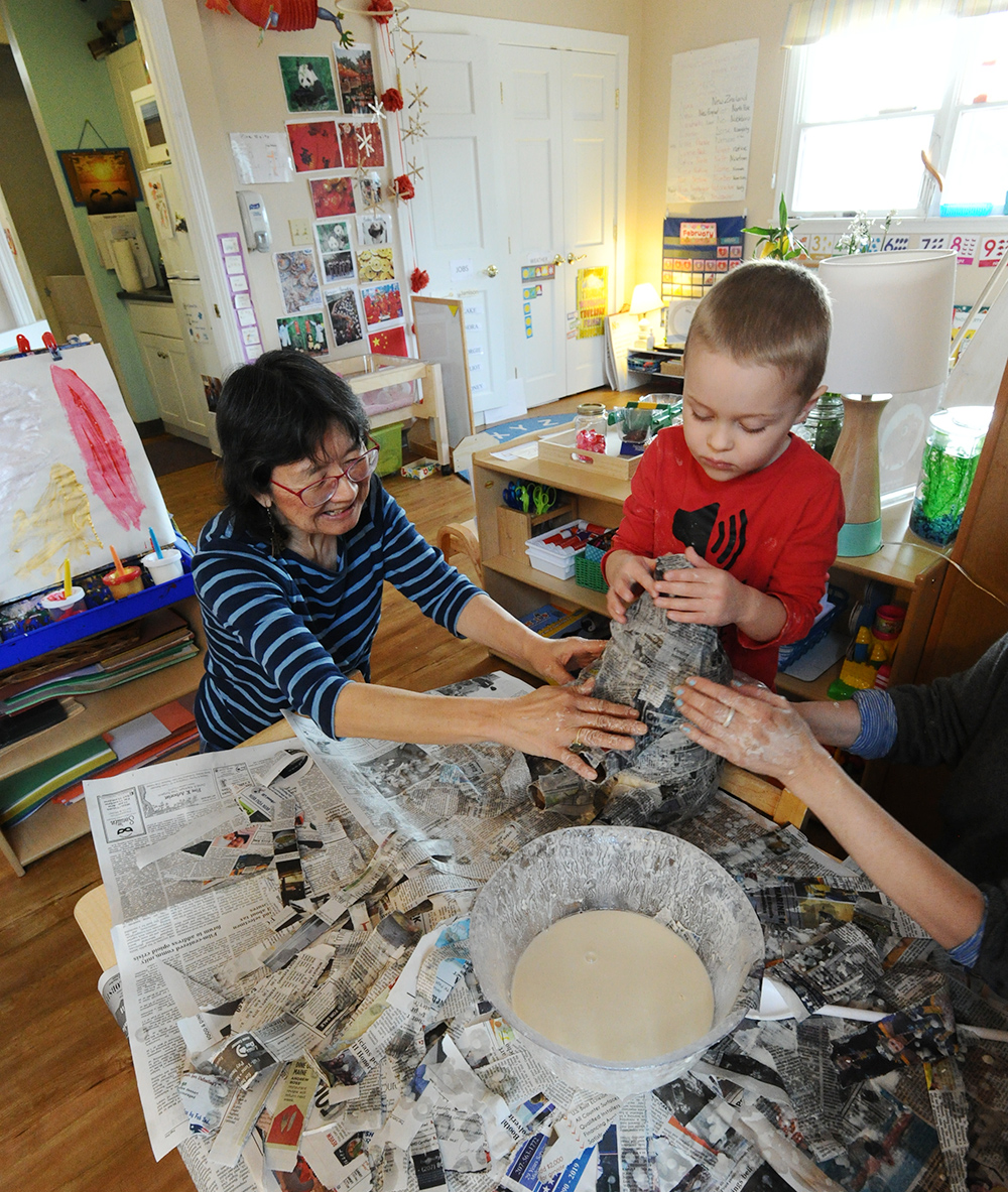 Teacher and student working on papier-mache