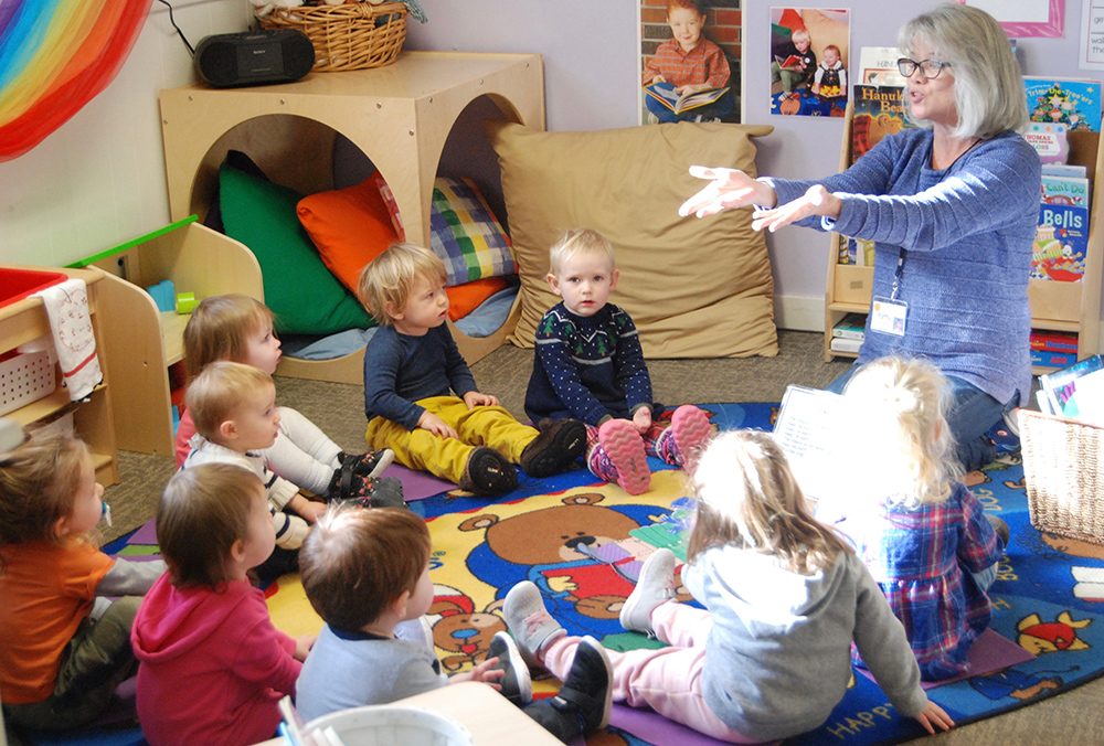 toddlers sitting in circle with teacher
