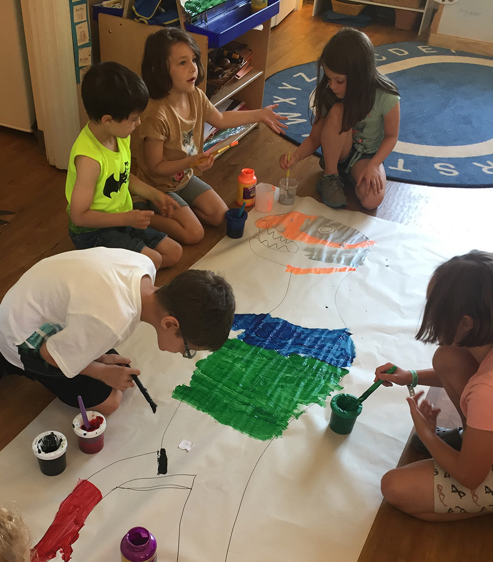 kids painting a big dinosaur